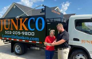 JUNKCO owner with a happy customer